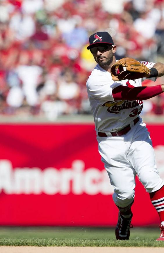 ST. LOUIS, MO - APRIL 14: Daniel Descalso #33 of the St. Louis Cardinals throws to first base during the game against the Milwaukee Brewers at Busch Stadium on April 14, 2013 in St. Louis, Missouri. The Milwaukee Brewers beat the St. Louis Cardinals 4-3 in 10 innings. (Photo by David Welker/Getty Images)