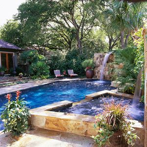 This rectangular shaped pool and attached waterfall is the perfect gathering spot for all ages all season long.