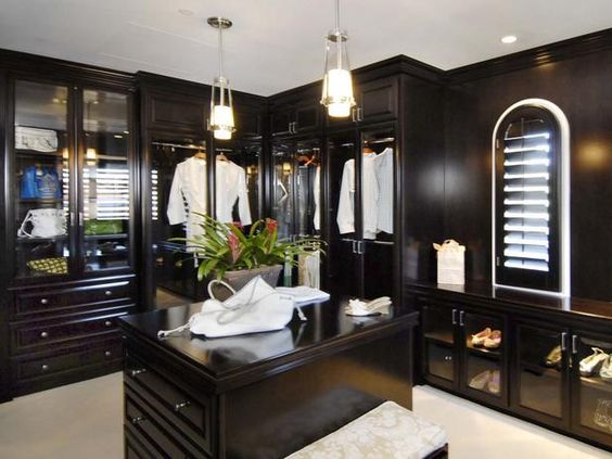 Fashionable Closet: Everything in this closet is designed to showcase fashion. The size easily accommodates many features, including elegantly illuminated cabinetry for shoes, a display for purses and a functional island.  From HGTVRemodels.com