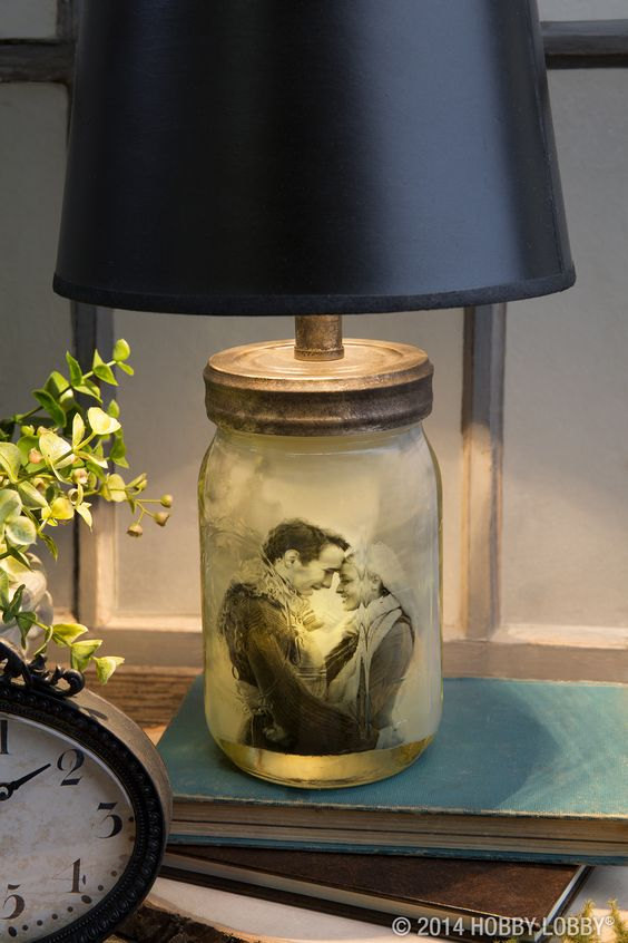 You won't find anything as personal as this off-the-shelf photograph suspended in vegetable oil. We sponged on some black paint to age the lamp kit a little, and we finished off the look with a simple black shade.
