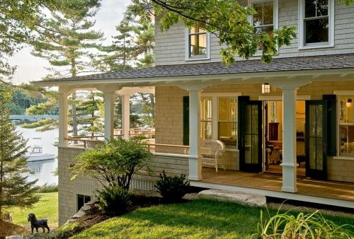 Love a big wrap around porch (the lake in the background is a PLUS too!)
