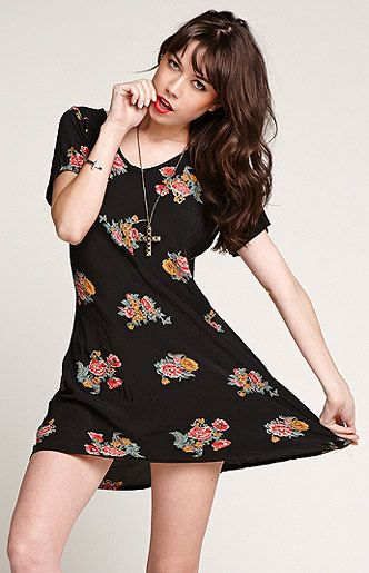 Day: wrap up in a cute cardigan over this dress. Night: Let loose in this cute black floral dress! Saltwater Gypsy Vintage Black Floral Dress at PacSun.com
