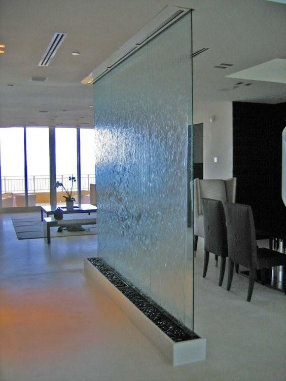 Frameless glass with waterfall as a room divider for Glass waterfall design
