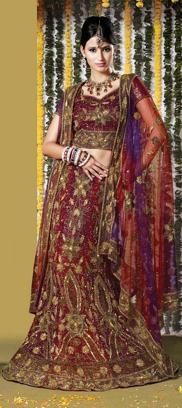 Beautifully designed theme based lehenga for bridal wear....Be The Center Of Attraction With This Crimson Silk Lehnga Choli. The Antique Zardosi, Bead, Bugle Beads/ Cutdana, Embroidery With Stones/Crystals..................  For more details or to buy at-> http://www.indianweddingsaree.com/product/68048.html