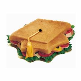 Grad Cap Sandwich! Hot roll mix, baked and shaped using our Topping Off Success Pan, is the foundation of this Grad Cap Sandwich. It's big enough to share but hungry seniors may mean you'll need still more than one!