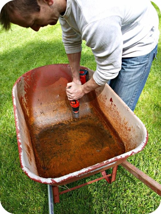 After years of use, you have decided to replace your old trusty wheelbarrow. But instead of tossing it, try this great DIY project to give it new life.