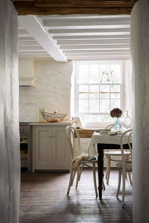 English country kitchen with stone walls, wood ceiling, and gorgeous serene decor. Come tour more European country kitchens to inspire. #english #kitchen #devol #farmhousekitchen #serene
