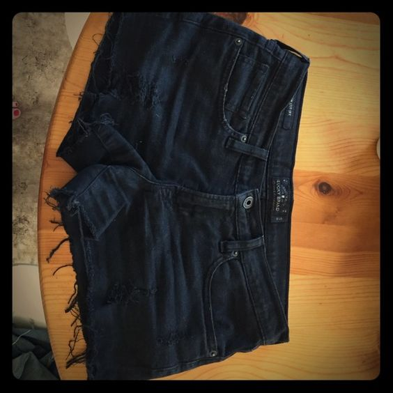 Lucky Brand cut off shorts Black, distressed Lucky Brand cutoffs, super cute and barely worn because they are too big! Lucky Brand Shorts Jean Shorts
