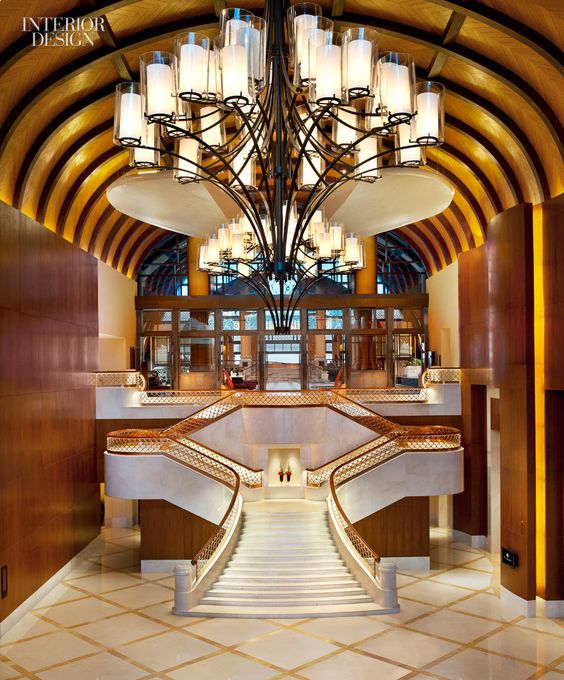 A grand staircase at the st regis sanya yalong bay resort for Grand staircase design