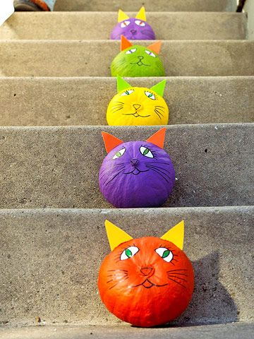 """Make a menagerie of colorful """"cat o' lanterns"""" to line your stoop"""