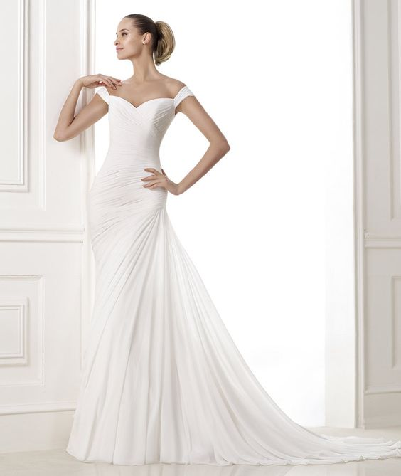 Pronovias Barcelona - BENA COLLECTION 2015 Fashion Gauze dress with draped bodice and off-the-shoulder neckline. V-back. Skirt with side draping.