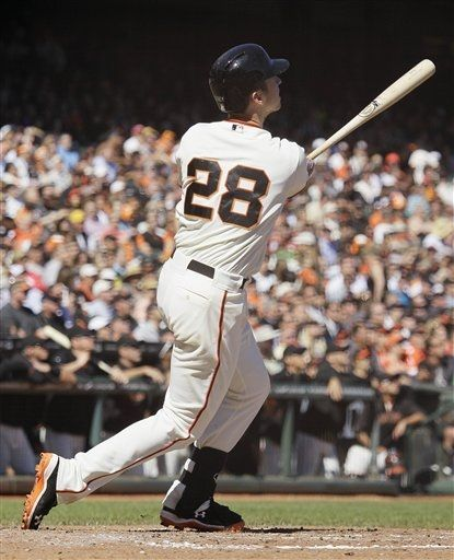 San Francisco Giants' Buster Posey hits a home run off Colorado Rockies relief pitcher Edgmer Escalona during the fourth inning of their baseball game in San Francisco, Thursday, Sept. 20, 2012