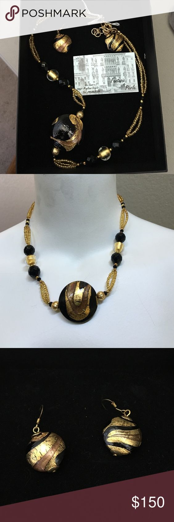 """Italian glass jewelry set Beautiful black and gold set made from Murano glass, purchased in Italy. Comes with certificate of origin from Fantasia e Perle. Earrings are for pierced ears and necklace is 20"""" circumference. Fantasia e Perle  Jewelry Necklaces"""