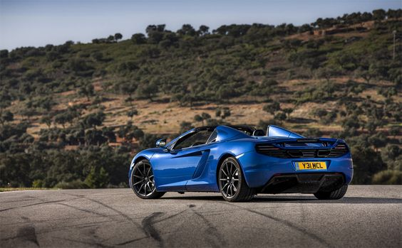 2014 McLaren MP4-12C Spyder, Azure Blue with the stealth pack, and no carbon fibre.