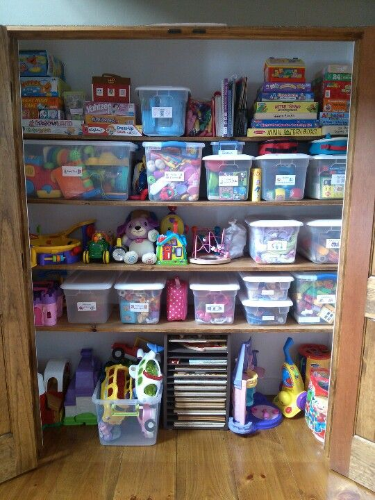 Coat closet turned into organized toy closet organize Storage ideas for toys in living rooms