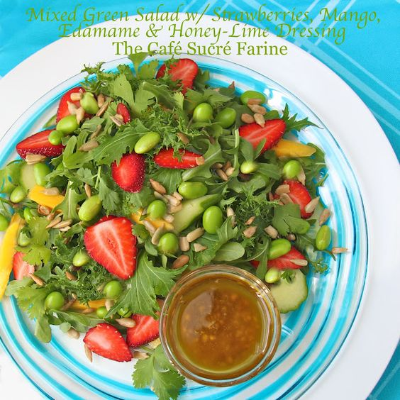 Mixed Green Salad w/ Strawberries, Mango, Edamame & Honey-Lime Dressing.