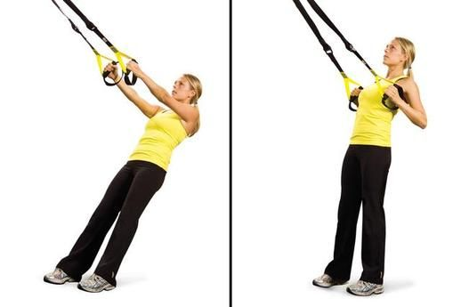 Lo Row - This exercise works all the muscles in the back. It really helps with posture issues Stand facing the anchor point, lean back with your arms straight with palms facing each other. Pull your body toward the anchor point and squeeze your shoulder blades. Return to start, maintaining the slight plank. STRAP ADJUSTMENT: Short.