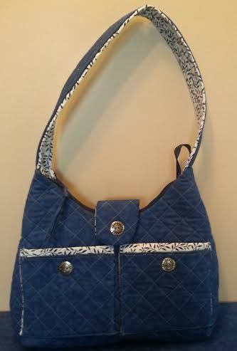 This is a nice sized purse with a lot of pockets.  It's quilted and easy to make.