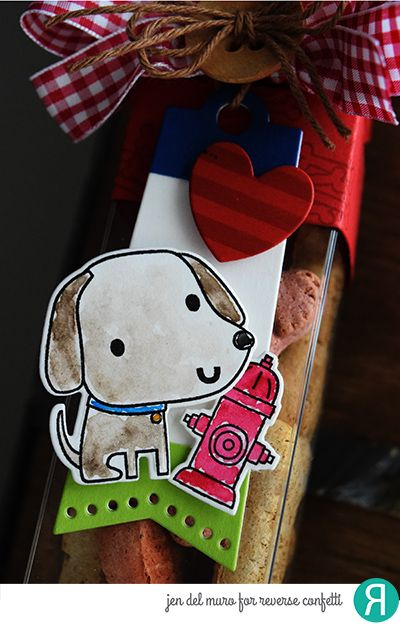 DIY treat box by Jen del Muro. Reverse Confetti stamp sets: Paw Prints and So Stripes. Confetti Cuts: Paw Prints, Tall Tag Trio, Love Note (heart) and Treat Tube Topper. RC cardstock: Navy and Lime Green. RC Ink: Brick. Doggie treats.