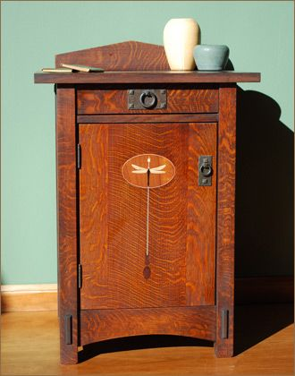 "Dragonfly Nightstand - featuring original Arts and Crafts dragonfly motif. Comes with one adjustable shelf and cedar bottom drawer. Custom sizes available. Dimensions: 31"" H 24""W 20"" D. Price: $1150.:"
