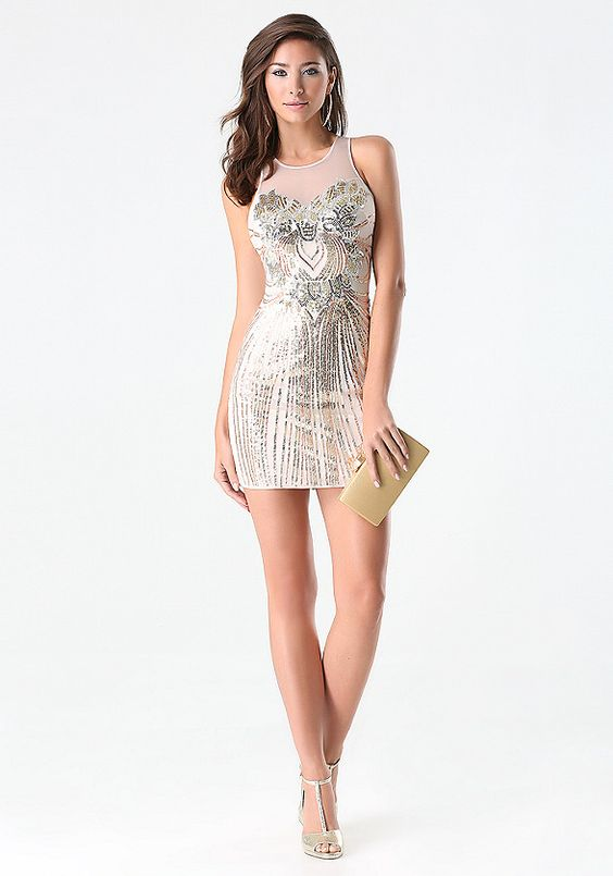 Drape yourself in decadence in this sequin embellished bebe cocktail dress, featuring mesh inset top and form-fitting bodycon silhouette.