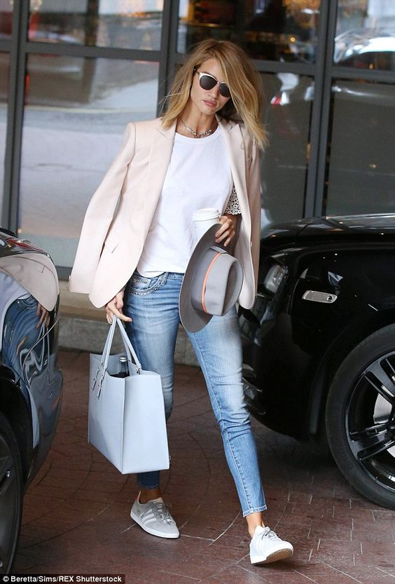 Making basics brilliant: Rosie Huntington-Whiteley looked rather lovely as she emerged from a building on Thursday while in London: