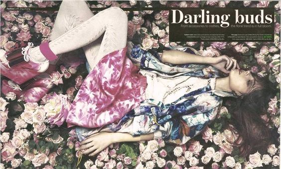 John Galliano FLOWERY SUMMER: SPRING SUMMER 2014 WOMEN COLLECTION  Short Skirt in marguerite print satin duchesse. 15 cm open toe trainer wedges covered with pink Marguerite Print silk duchesse. White patent leather ankle strap. Giant bow with dégradé in pink paillette and white velvet piping, set with a multicolor 3D pink flower.  Featured in Sunday Morning China.