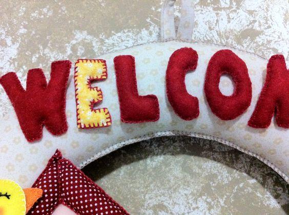 Detalhe enfeite de porta em feltro. Letras Welcome