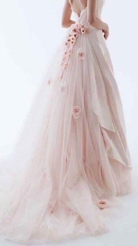 blush wedding dress with large pink flower
