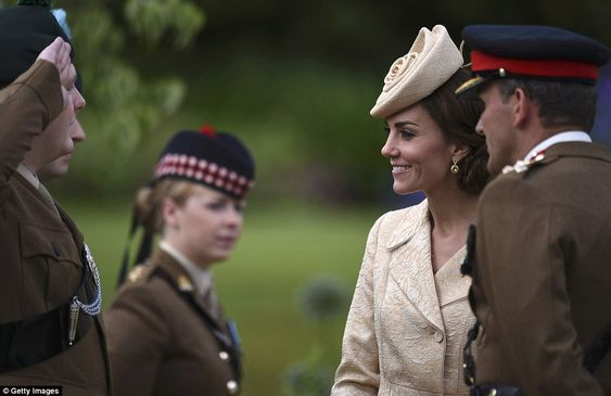 The Duchess seemed ever charming as she made her way along a line of soldiers with each of whom she stopped to chat with: