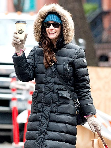 Liv Tyler, is that YOU? We barely recognized the gorgeous gal under sleek wayfarer-inspired shades and an oversized puffer coat!