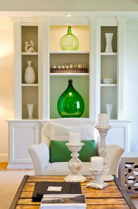 White and Green Interiors. Green Interior Ideas. White bookcase with green decor. #GreenInteriors #GreenInteriorIdeas. Evars and Anderson Interior Design.: