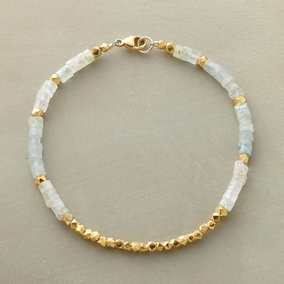 """LIGHT FILLED BRACELET--The unmistakable glow of 18kt vermeil warms aquamarine's cool blue-greens. 14kt goldfill clasp. Handcrafted in USA exclusively for Sundance. 7-1/2""""L."""