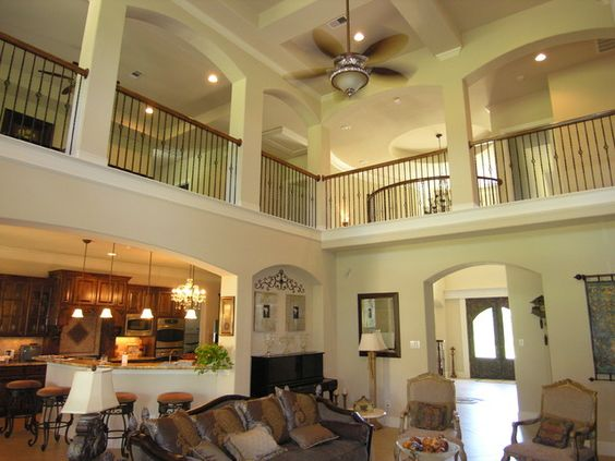 Second floor open i love interior balconies and open for Two story living room house plans