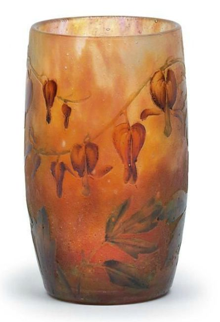 A small beaker vase decorated with bleeding hearts,  Daum, Nancy, c. 1905/14, the colourless glass decorated with a dense pattern of raspberry red and orange inclusions, overlaid in light green and embellished with acid etched and polychrome painted bleeding heart motifs, frosted ground, with raised signature Daum Nancy and the Cross of Lorraine to the wall, height 8.5 cm