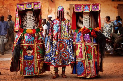 Nigerian Yaruba dressed as voodoo spirits perform during a voodoo ceremony in Ouidah, Benin. Each spirit represents the reincarnation of a dead member of the Nigerian Nagu clan Photograph: Dan Kitwood/Getty Images