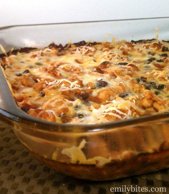 Bubble Up Enchilada Casserole - filling, delicious and easy to make for a perfect weeknight meal. Just 307 calories or 7 Weight Watchers SmartPoints per serving! www.emilybites.com