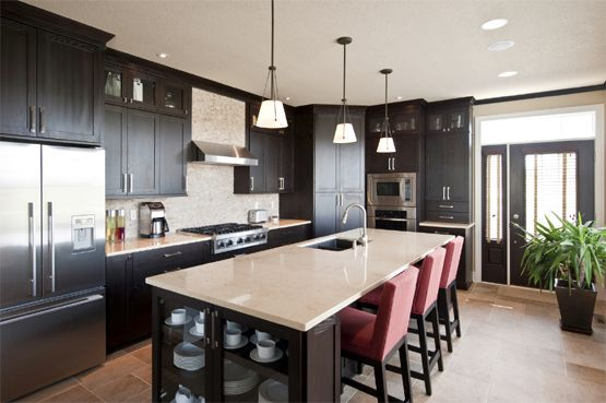 another version of dark cabinets, stainless steel appliances, light countertops and backsplash