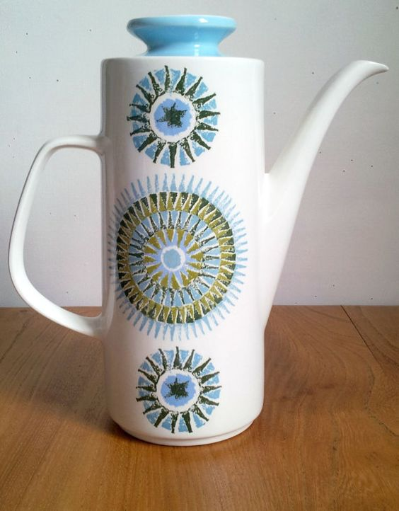 J&G Meakin Aztec design Coffee Pot. A great example of mid 60's ceramic homeware.    Designed by Alan Rogers, the Aztec design is a wonderful combination of olive green and blue circular patterns. The coffee pot measures approximately 24.5 cm tall and is the classic Studio 2 shape
