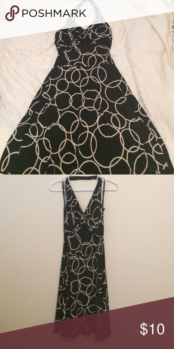 Black and Ivory Dress Black polyester dress with ivory circle design. A fun and playful dress, great for a night out! There is a knot at the chest and a slimming a-line design. This dress hits at the knees. KDL Signature Dresses Midi