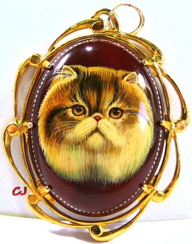 """Russian original art """"hand painted"""" Persian cat cameo Pendant Jewelry. Painted on a somewhat translucent, red Carnelian, Semi-precious gemstone, oval cabochon. Artist signed on the back and comes with 4 coats of lacquer for superior protection! Large cameo 1.5"""" x 1-1/8"""" widest... doesn't include the setting size which is approx. 2-1/8"""" x 1-5/8"""" widest. Persian cat cameo is set in a 12k Yellow Gold Filled prong setting. Excellent Condition. www.etsy.com/shop/SylCameoJewelsStore"""