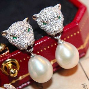 PEARLFECION / Cartier Panthere De Cartier Earrings in White Gold with Diamonds and Emerald and Pearl