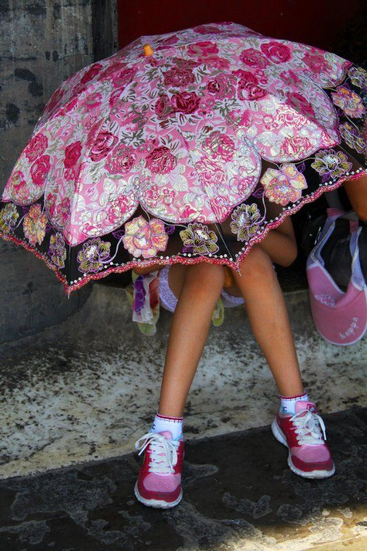 pink shoes and umbrella