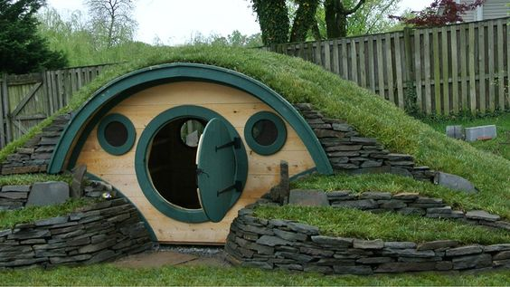 """Hobbit hole playhouse! This would be awesome and you could teach how to garden around their """"home"""""""