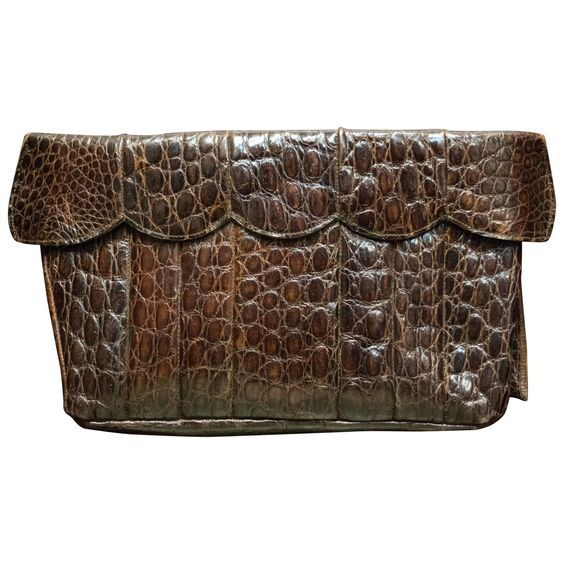1940s Brown Alligator Clutch  | From a collection of rare vintage clutches at https://www.1stdibs.com/fashion/handbags-purses-bags/clutches/