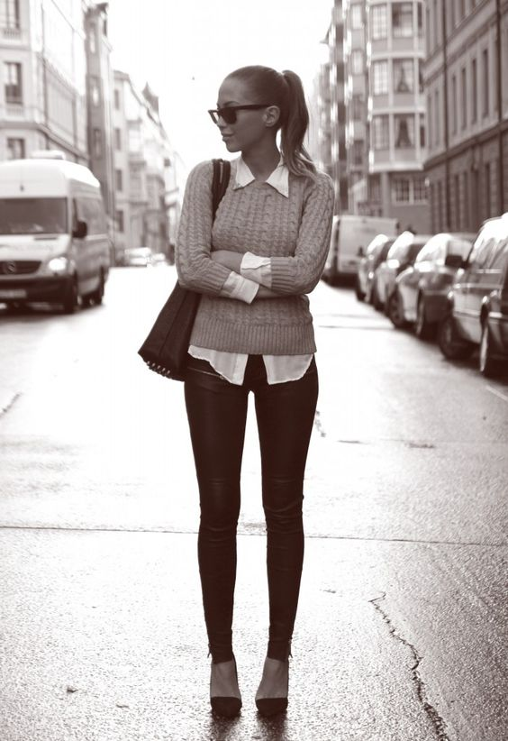Style-it-up: City girl in black skinny jeans, knit sweater, and collared skirt looking pretty chic.
