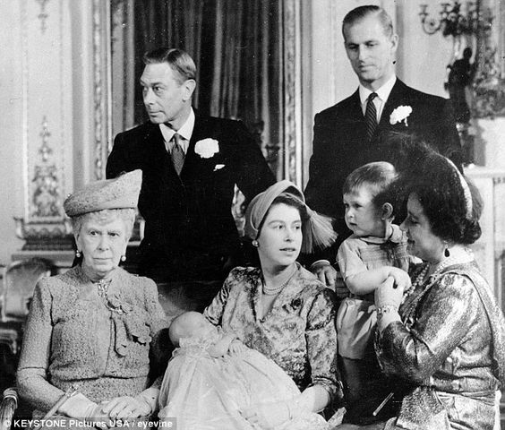 From left: Queen Mary, King George VI, Princess Elizabeth (later Queen Elizabeth II) holding Princess Anne, Duke of Edinburgh ( Prince Philip) and Queen Elizabeth ( Queen Mother) holding Prince Charles.