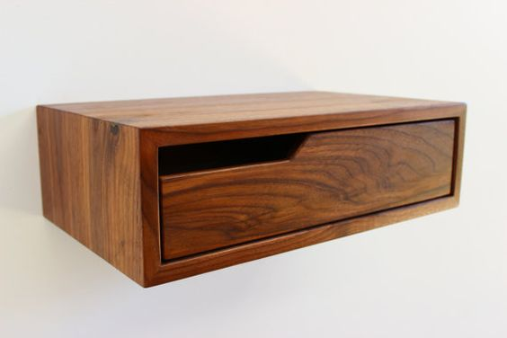 These are floating nightstands or consoles. Made out of Solid Walnut. With mitered continuous wrap around grain on the top and sides , concealed
