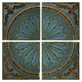 """Set of 4 iron wall panels with medallion motifs. Product: 4 Piece wall decor setConstruction Material: MetalColor: Teal and rustFeatures:  Charming designWill enhance any settingDimensions: 15.75"""" H x 15.75"""" W each"""