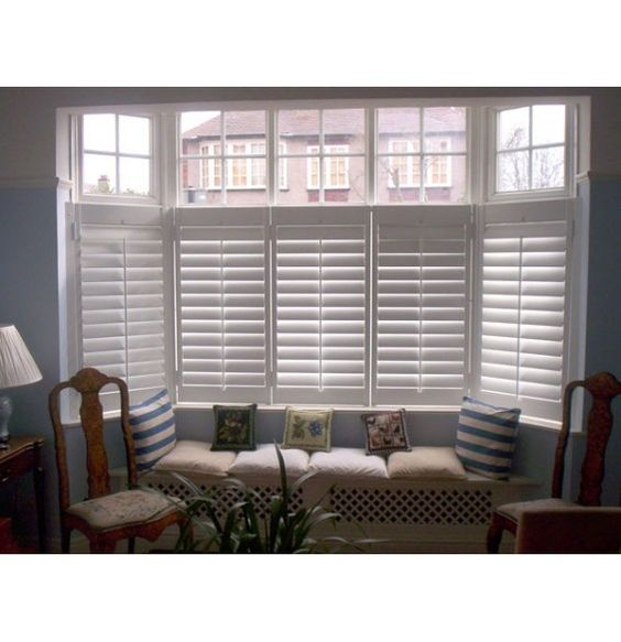 Cafe style bay plantation shutter and built in window seat for Windows with built in shades